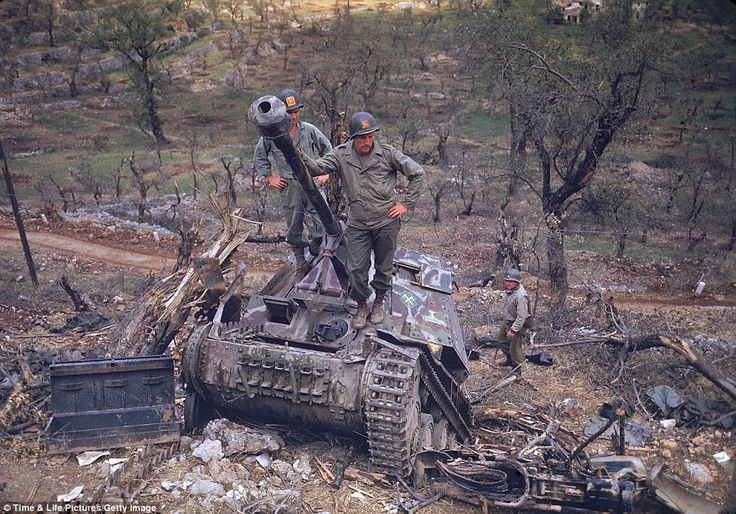 Unrelenting: American soldiers looking over German armor destroyed during the drive towards Rome. The Italian Campaign began with the bootin...