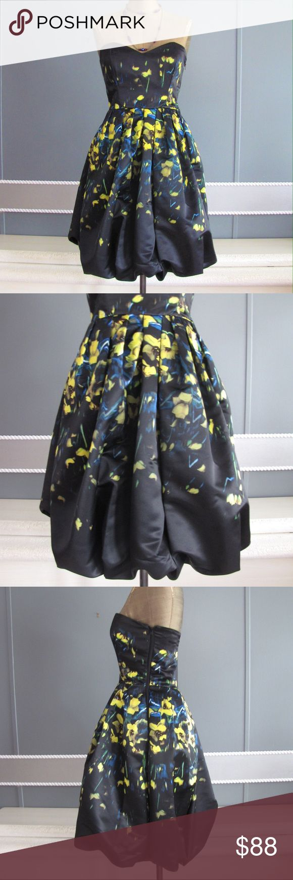 Parker black label bubble strapless dress sz 2 Parker Black Label strapless bubble hem dress *Sz 2  *new with tags *Color/pattern: swallow tail. Black with yellow and blue  *strapless design *pleated skirt *dual on-seam pockets  *elasticized back bodice *bubble hem. Parker Dresses Strapless