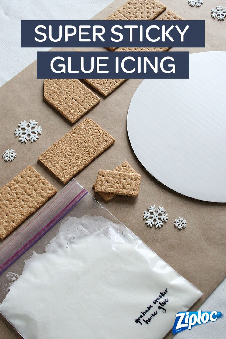 "Baking a gingerbread house from scratch can take an entire day. And then when you take the time to assemble it, all the pieces fall apart. To avoid an epic mess, use graham crackers and our ""glue"" icing recipe!   Cut off the corner of a Ziploc® bag to pipe frosting for gingerbread houses!"