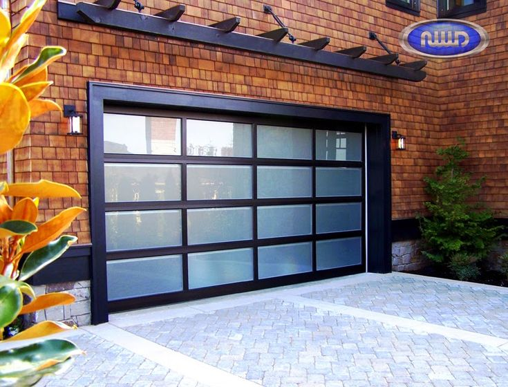 I love this beautiful contemporary garage door manufactured by Northwest Door. It has a clean, yet  stylish design. The Modern Classic is a stile and rail garage door made with an all-aluminum construction. The design can be customized to your specifications. Choose from glass or aluminum panels, painted or anodized finish. The panel width and height can also be reconfigured.