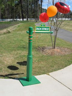 DIY Sesame Street sign idea with your child's name will make a big impression at your Elmo birthday party.  See more Elmo birthday party ideas at www.one-stop-party-ideas.com