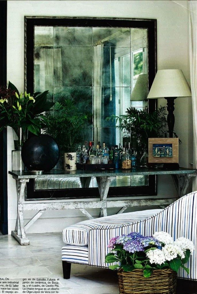 oversized mirror in antiqued glass behind the bar sideboard. from Le Petitchouchou