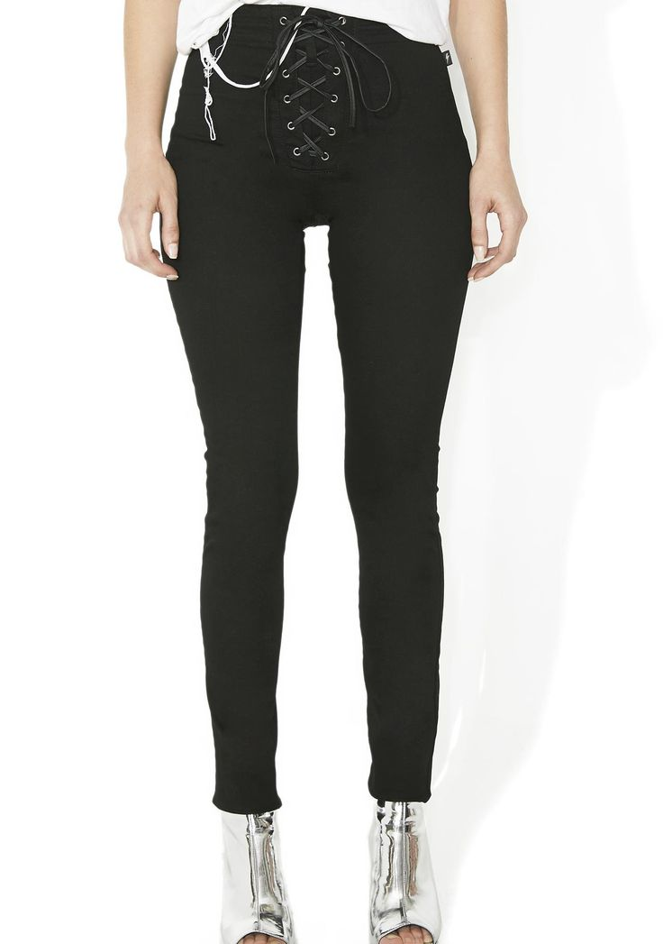 Tripp NYC High Waist Corset Pant cuz you don't mind getting a little tied up, bb. These high waisted pants feature a stretchy, skinny fit and a faux leather corset lacing that ties up from the front to back, that's complete with a front hidden zip closure.
