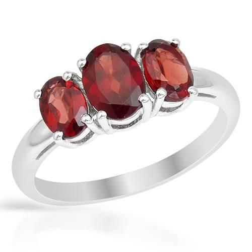 Silver Ring With Garnets - Size 6.5 Ring beautifully crafted in 925 sterling silver with garnets. Total item weight 2.2g. Size 6.5. Gemstone info: 2 garnets, 1.30ctw., with oval shape and reddish brown color, 1 garnet, 1.15ctw., with oval shape and reddish brown color.