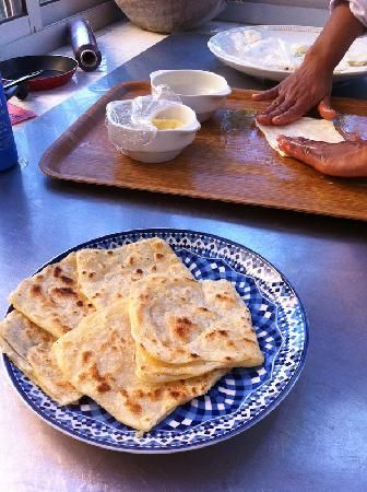 M'semmen - This is a Moroccan flaky flat almost crepe like bread. Best eaten warm it is well loved here for breakfast with butter, sugar, honey, cinnamon, ...