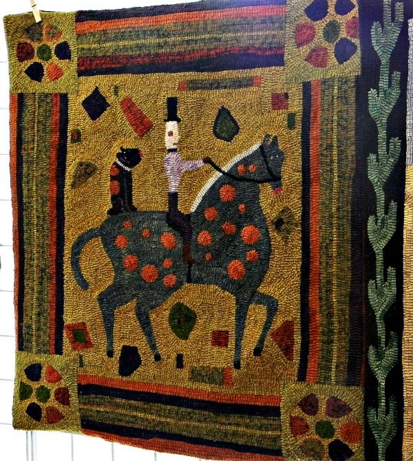 Primitave rug hooking #Arts and #Crafts man on horse at #NYS Sheep and Wool Festival