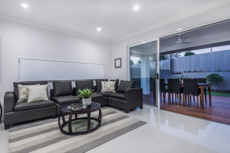 #Living #room #ideas from Ausbuild's Bellfield display #home.This room #features a #deep #grey #fabric #lounge and #earthy #inspired #wooden #coffee #table.