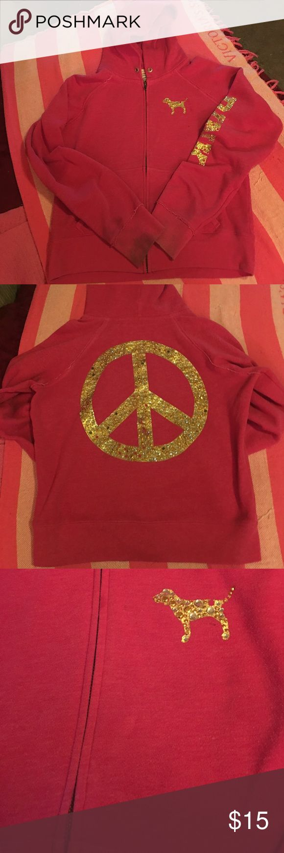 Victoria's Secret Pink hoodie sz L Pre owned VS Pink full zip hoodie sz L. This hoodie matches the sweats I have listed, it's missing the drawstring, it has a dog on front (missing one rhinestone) and a large peace sign on back (missing a few rhinestones) and says Pink down the arm that's missing some rhinestones too, the cuffs are stained it may come out or get lighter with stain remover I haven't really tried, I washed it and hung it to dry so it shouldn't be set it. Light spots near dog…