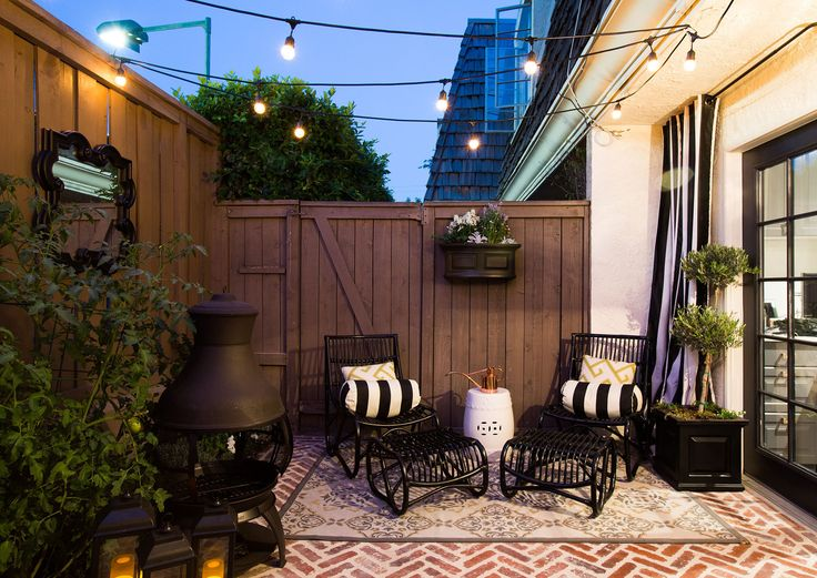 Transform your patio into your outdoor living room. Garden stools, string lights, wall decor, and an outdoor area rug make this space prime for unwinding.
