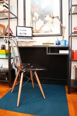 Hang a black drop cloth behind your desk to hide a tangled mass of wires.   36 Genius Ways To Hide The Eyesores In Your Home