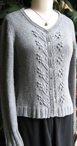 Classic cardigan with a vintage attitude, modern fit, and charming details including a cable and bobble berry border, pretty cable-decrease shaping, and a tidy hemmed stockinette band.