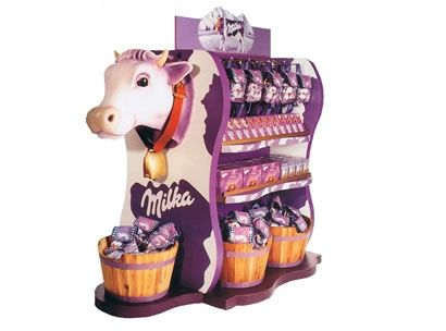This POD is really clever and aesthetically pleasing as, the chocolate product in the picture is made from milk and is graded 'milka' and the cow shows that the product is good quality and from happy cows. This would catch the attention of children and is more interesting to look at rather than a boring old row of chocolate bars.