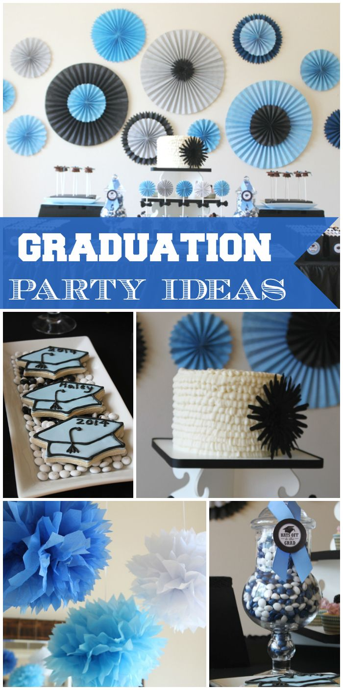 A blue and black graduation party with pom-pom and medallion party decorations, a ruffle cake and candy jars! See more party ideas at CatchMyParty.com!