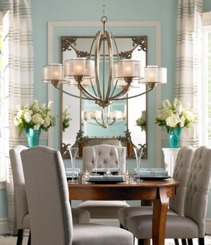 high drama and low profile merge effortlessly in this traditional dining room lighting - Transitional Dining Room Chandeliers