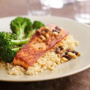 Seared Salmon with Braised Broccoli Recipe by eatingwell: Pair pan-seared salmon with braised broccoli and make it special with a quick, Italian-inspired topping of sautéed onions and pine nuts. Skip the raisins for #FastMetabolismDiet Phase 3. #Salmon #Healthy
