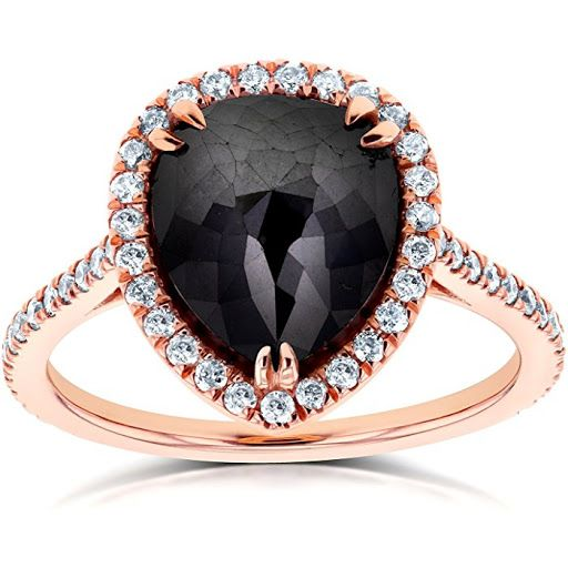 Kobelli 14K Rose Gold 4.30 ctw Pear-Cut Black Diamond Halo Ring Style your up-to-the-minute look like a real lady embrace your femininity and say Hello to the world of fine jewelry with this sublime engagement ring crafted in the charm of 14 rose-gold karats. The center of this Kobelli ring measures 12.15 millimeters in width is embellished with a majestic pear-shaped black diamond and 57 white diamond accents that form a beautiful pave-set halo. All of the diamond stones adorning this piece…