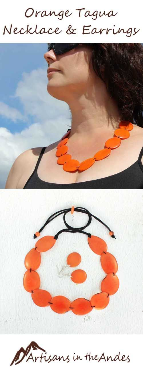 Charming necklace, with a slip tie in the back at various lengths. This necklace comes with matching earrings, a perfect look for a fun evening out.  The orange oval-shaped beads are slices of tagua nut, a very hard nut, similar in appearance to ivory. #style #fashion #shopping