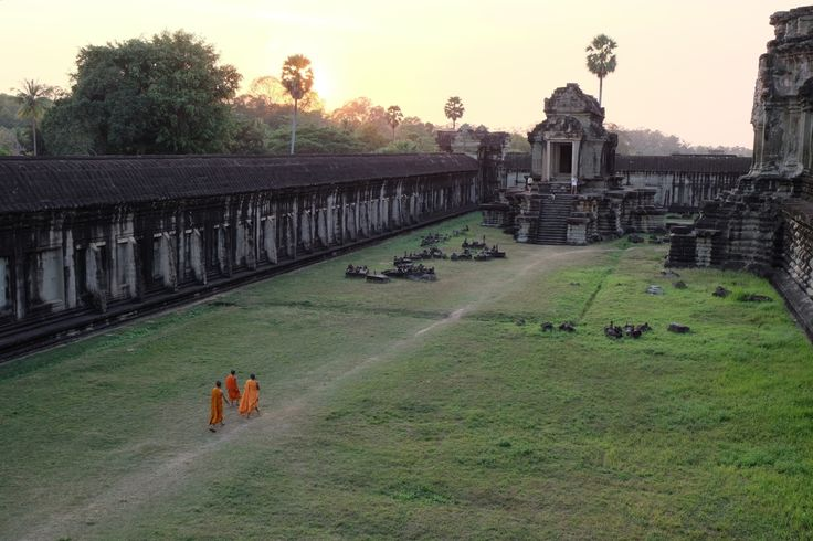 Monks walking out, a busy tourist day almost over @ Angkor Wat, Siem Reab, Cambodia