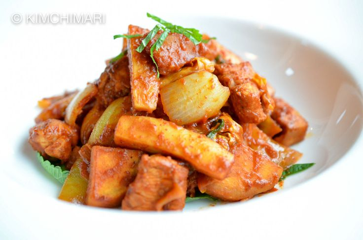 Dakgalbi (Korean Spicy Chuncheon Chicken Stir-Fry) is often cooked at the table with sweet potatoes, rice cake and vegetables in spicy gochujang sauce.