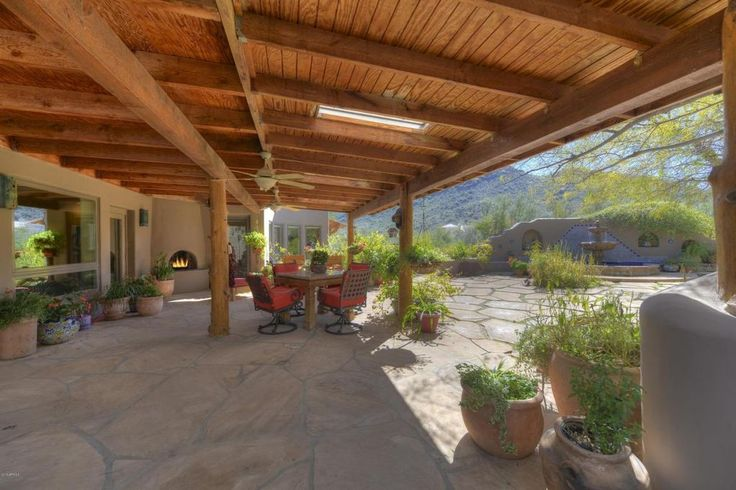 Southwestern Porch with Fence, Wrap around porch, Fountain, Skylight, exterior stone floors, Raised beds