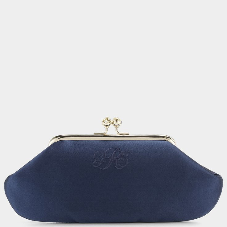 A classic Anya Hindmarch hinged clutch bag which can be embellished with embroidered initials. The interior can also be embossed with a hidden personal message that will make the owner smile every time she uses it. The Maud makes a perfect wedding gift to commemorate a special day for the bride, her mother or her bridesmaids. Find an old fashioned dance card tucked away inside.<br><br>Item number: 5050925608534