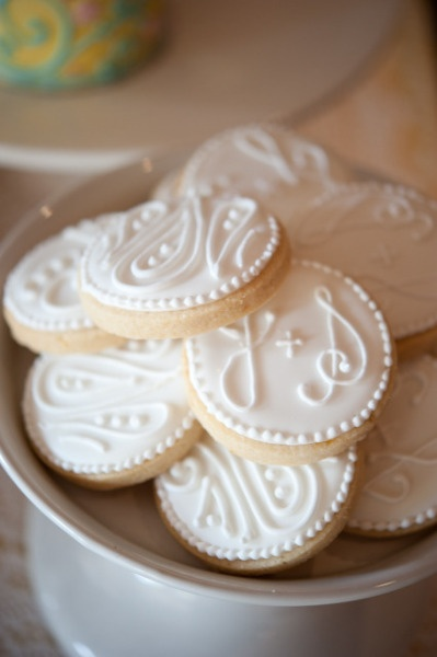 Cookies styled with a paisley motif and the couple's monograms.
