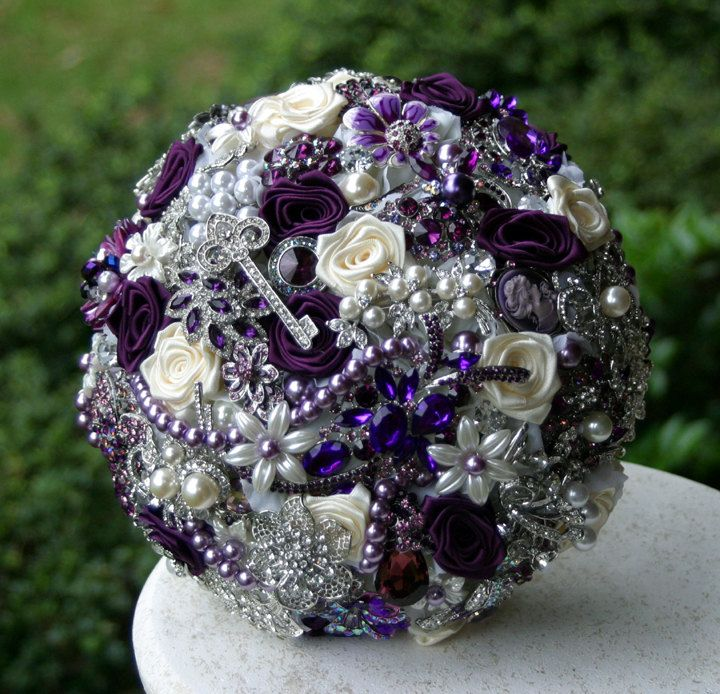 Purple Brooch Wedding Bouquet. Deposit on made to order heirloom bouquet. Broach wedding bouquet.. $75.00 deposit, via Etsy.