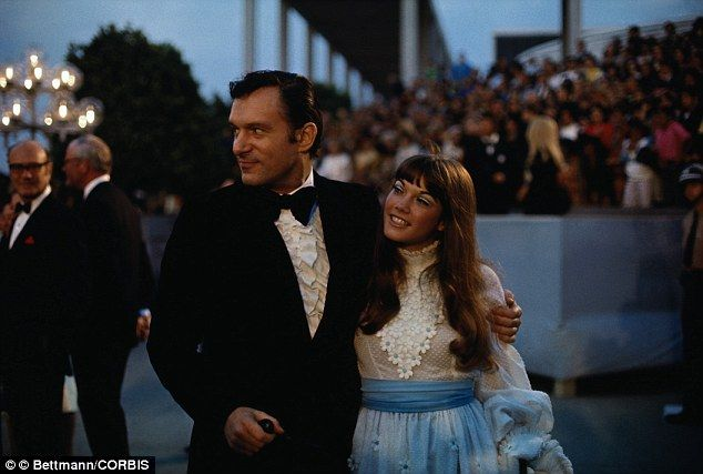 Hefner is accompanied by Barbi at the 1970 Academy Awards...