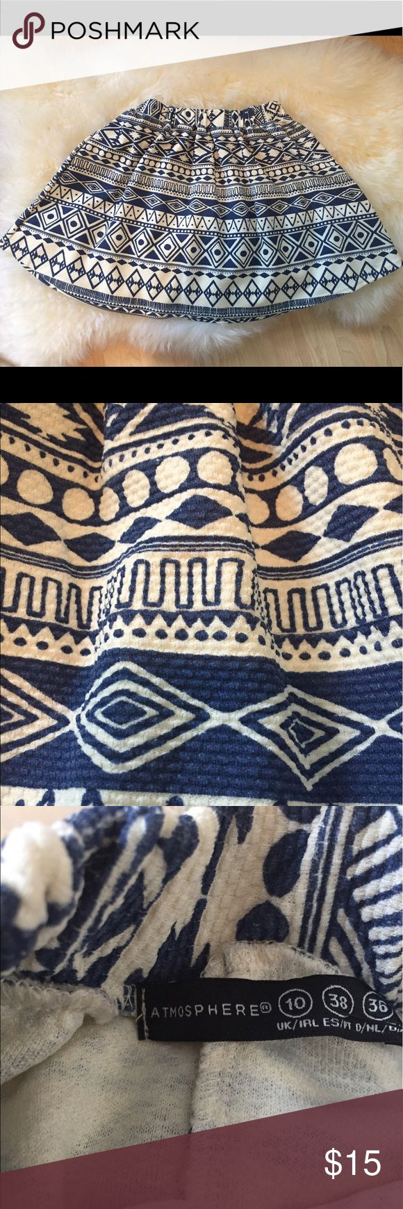 """Tribal Print Skirt By Atmosphere Adorable blue and white Atmosphere Skirt in trendy Aztec/tribal print!  This cute skirt is ready for spring and summer!  Elastic waistband for max comfort.  Measures 16.5"""" long and 12"""" wide at the waistband.  This skirt is a U.K. Size 10, which translates to a US size 8, but I think it runs a little small. Atmosphere Skirts Mini"""