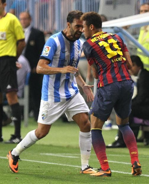 F.C. Barcelona's Neimar from Brazil, right, argues with Malaga's Jesus Gamez, left, during a Spanish La Liga soccer match at La Rosaleda stadium in Malaga, Spain, Sunday, Aug. 25, 2013