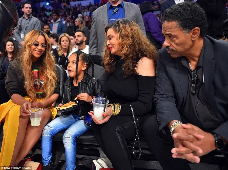 Center of attention: Blue had all eyes on her during the game including Los Angeles Lakers CEO and co-owner Jeanie Buss in the backgound