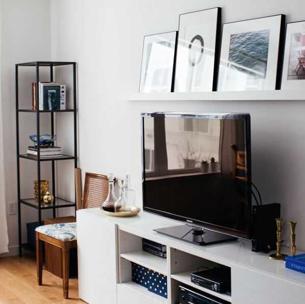 picture ledge above tv, skinny bookshelf+chair next to tv