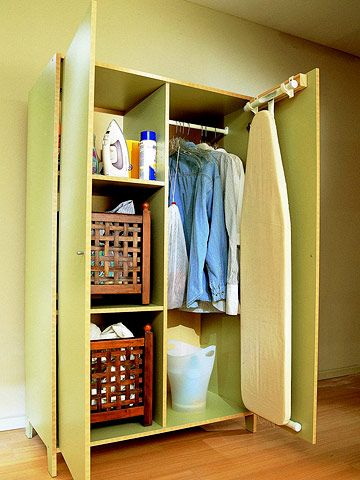 Attractive A Freestanding Armoire Or Cabinet Hides Hampers, Ironing Board, And Laundry  Supplies Behind Closed