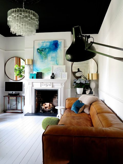 47 Park Avenue ... such a dramatic turn, painting the ceiling black.  the rest of the white-washed living room looks clean and warm (brown leather sofa, painted wood floor beams) and almost Scandinavian but the black takes it to another level