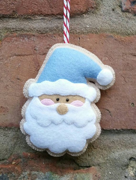 Here is my adorable handmade Santa ornament. It has been made from 100% wool felt, which is the best quality felt you can buy. It has been hand stitched and measures approximately 2 1/2 by 3 1/2 inches.   As with all of my ornaments I can change the colours to match your christmas colour scheme. If you have any question please dont hesitate to contact me xxx
