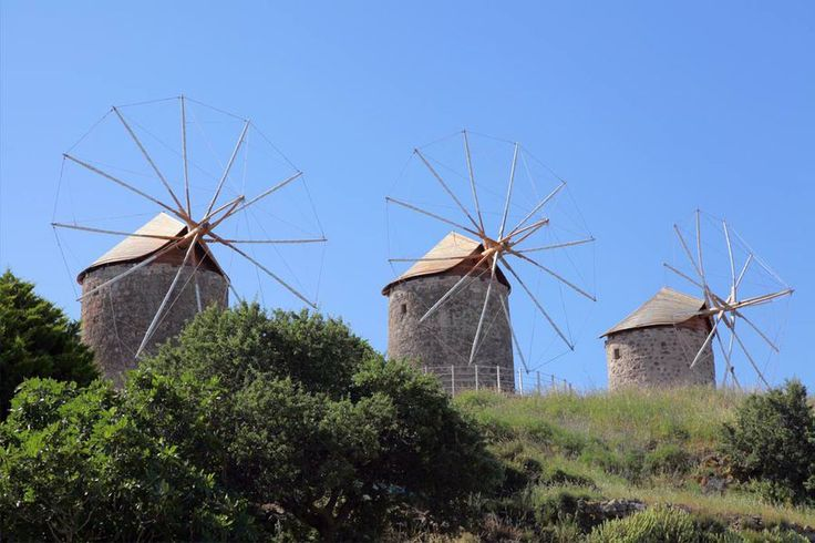 Patmos island, Dodecanese. The hill of north-easterly Holy Abbey of Saint Ioannis the Theologian is dominated by three imposing traditional windmills, the cloth blades of which turn again after 50 years of disuse and abandonment. Source: www.greekguide.com