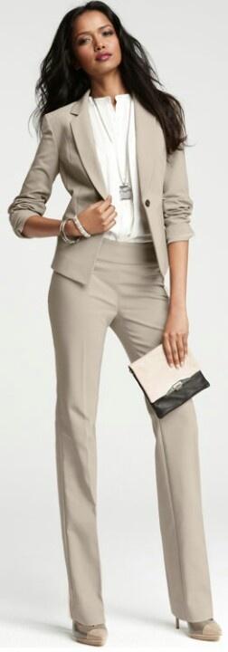 Beige/ khaki suit with a white shirt