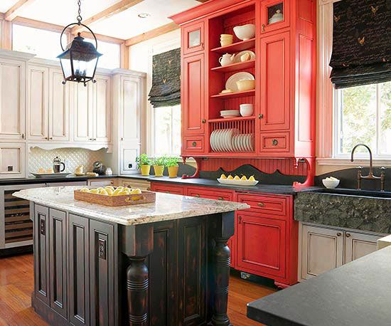 In this farmhouse kitchen, red really pops against the white cabinets and black surfaces.