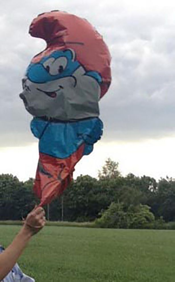 Police alerted for 'bearded man with blue coat' on train track – was actually a Papa Smurf Balloon