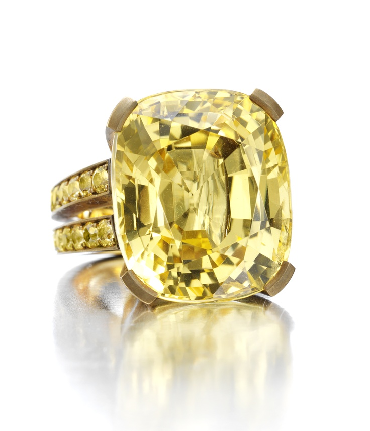 You just can't get any better that this!   A Single Natural Yellow Sapphire Ring of 55.35cts.  Set in Copper with Yellow Sapphire Pave