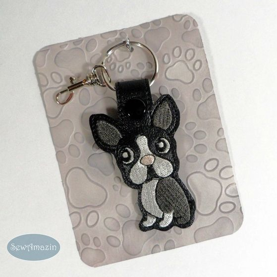 Charming key fob is perfect for Boston Terrier owners! Made of vinyl, includes a split key ring and optional swivel lobster clasp so you can attach it to your key ring or purse. Can be made to order and customized in other colors.