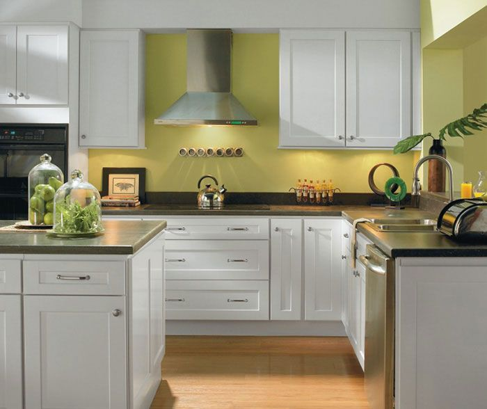 Just like their city namesake, these Sedona Alpine White Shaker style kitchen cabinets help to create a calm, spiritual environment. Under cabinet lighting highlights the black countertop against the crisp white finish. Celery green walls tie it all together for a serene space to practice the culinary arts.