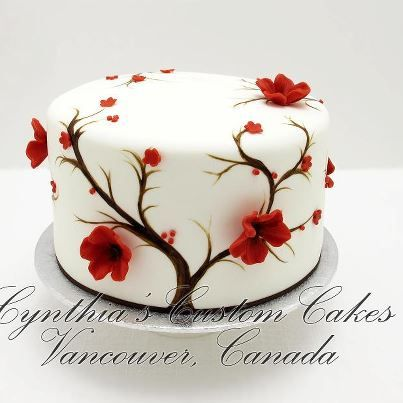 I really like the combination of hand painted designs along with 3 dimensional sugar flowers.