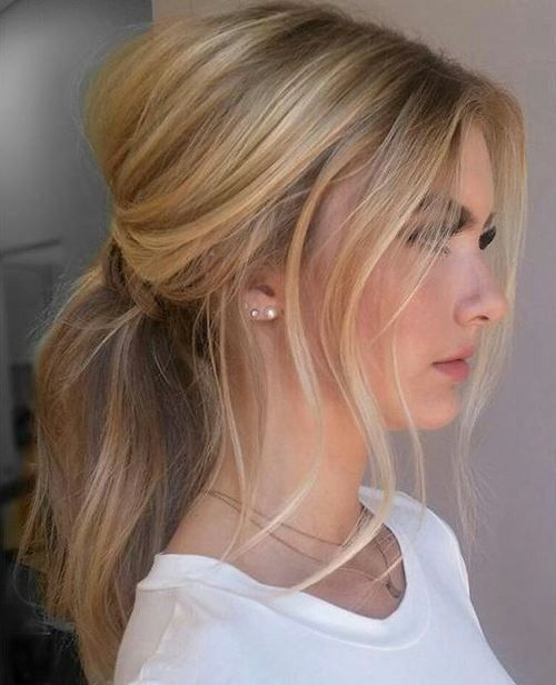 Sweep hair into a low ponytail and let pieces fall out on the sides. Tug…