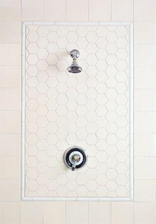 Hexagon tile framed out around bathroom fixtures