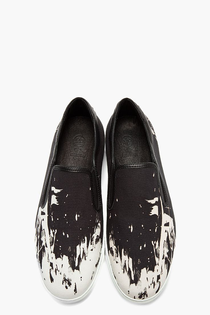 MCQ ALEXANDER MCQUEEN Black textile and leather white-splattered slip-ons