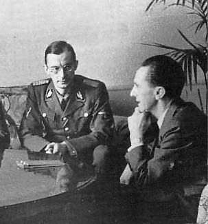 Erhard Kröger, leading Baltic German nationalist politician who oversaw the transfer of Baltic Germans, meets with German Propaganda Minister Joseph Goebbels. (via indesirableprincesse)