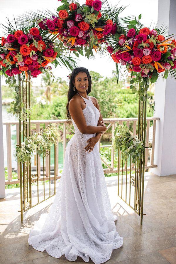 Colorful ceremony arch    #wedding #weddingday #aislesociety #weddingceremony #tropical #bride