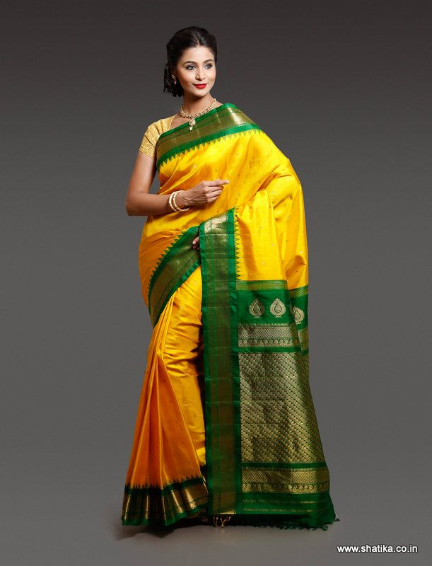 Colored in the traditional weaves of Gadwal sarees is Chandika Yellow and Green Pure Gadwal Silk Saree with richness of colors,fabric and weave. This Gadwal Silk is crafed by Vinayak Apte of Gadwal.