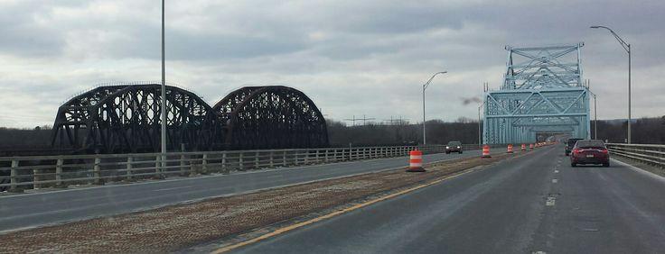 Interstate 90 bridge over the Hudson River near Albany NY , and railroad bridge.